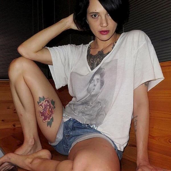asia argento flower tattoo on thigh